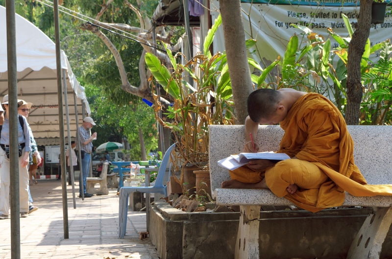 Daytime EyeEm Gallery Architecture Buddhism Budhist Building Exterior Day Daytime Photography Eye4photography  Full Length Lifestyles Men Nature Outdoors People Real People Sitting Studying Tree Young Adult
