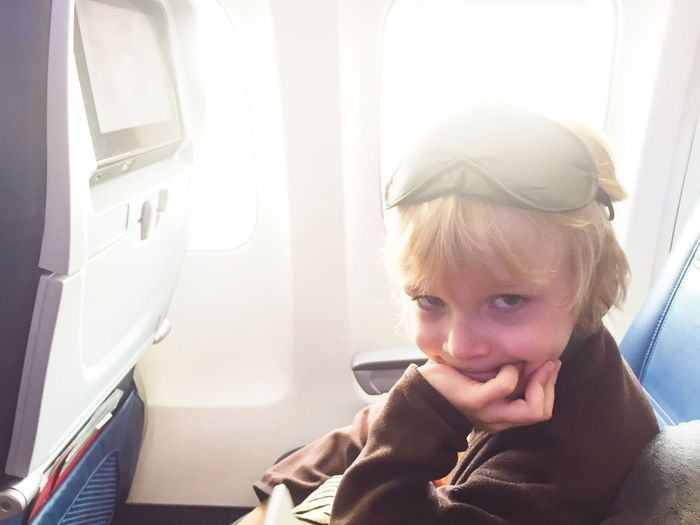 Young woman sitting in airplane