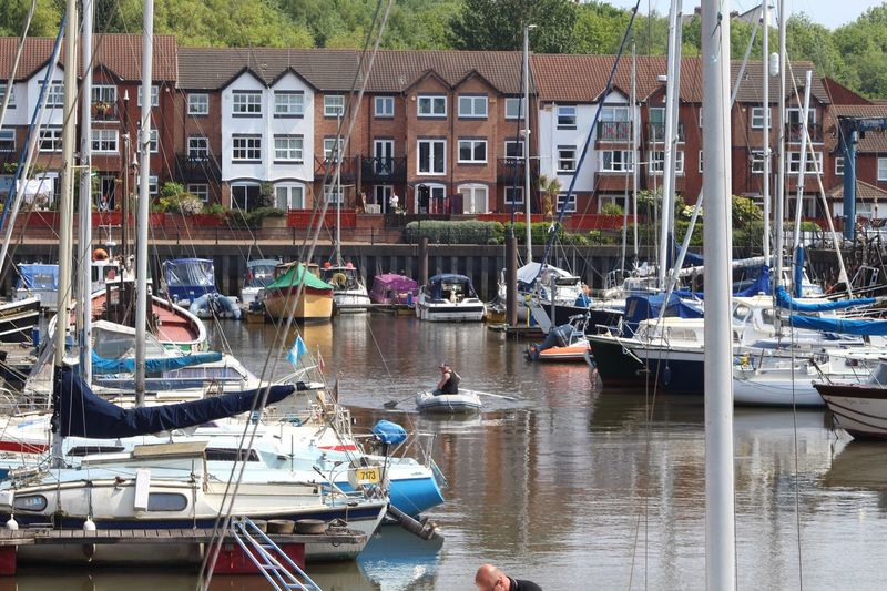 Boats Moored In Canal By Houses