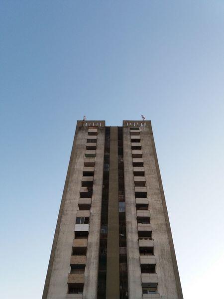 Low Angle View Architecture Built Structure City Skyscraper Clear Sky No People Sky Textures Socialist Realism Socialist Architecture Housing Estate Concrete Concrete Building Simmetrical Building Simmetry