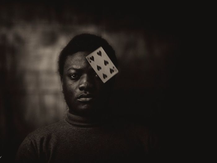 Portrait of man with playing card