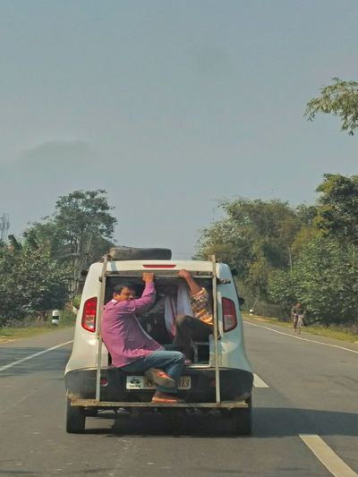 Funny MAN Adventure Small Car Sitting Funny Man Morning Journey Enjoyable On The Highway Two People Only Men