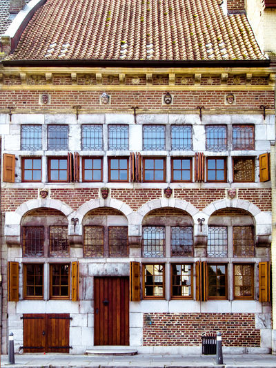 Facade of old picturesque house Belgium Home Maaseik Shutters Wood Ancient Architecture Building Building Exterior Built Structure Design Door Facade Building House Limburg Medieval Medieval Architecture No People Old Old Buildings Old House Outdoors Roof Street Windows Wooden
