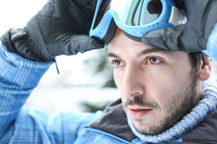 portrait of young man looking away Active Beard Casual Clothing Contemplation Cross-Country Skiing Facial Hair Focus On Foreground Front View Happy Headshot Holiday Human Face Leisure Leisure Activity Lifestyle Lifestyles Looking Looking At Camera Man Men Neutral Outdoors Outside People Portrait Put On Real People Serious Set Down Ski Ski Goggles Ski Holiday Ski Trip Skier Skiing Snow Sport Winter Winter Holiday Winter Sports Young Adult Young Men