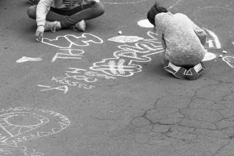 Berlin Berlin Photography Black And White Blackandwhite Chalk Drawing Childhood City City Life Day Daytime Drawing Human Body Part Human Leg Kids Leisure Activity Lifestyles Low Section Outdoors Playing Schwarzweiß Street Photography Streetphotography Urban Art Is Everywhere Discover Berlin Connected By Travel
