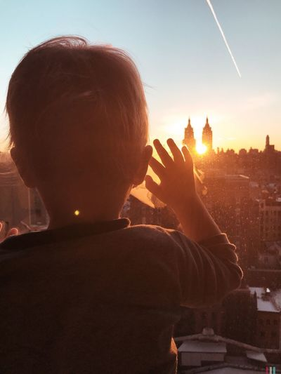 Good morning, New York Real People Sunlight Headshot One Person Leisure Activity Holding Rear View Lifestyles Sun Sunset Sunbeam Outdoors Sky Day Architecture Human Hand Young Adult Close-up People