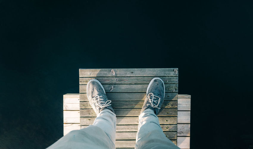 Jump Adult Anxiety  Boardwalk Canvas Shoe Close-up Day Depressed Depression Depression - Sadness Dock Hight Human Body Part Human Foot Human Leg Low Section Men One Person Outdoors Pair People Personal Perspective Real People Shoe Standing Water