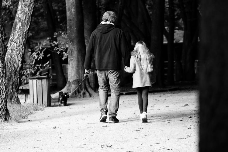 Father And Daughter Day Two People Tree Walk Stroll Walking Tour Outdoors Taking Photos EyeEm Best Shots - Black + White Check This Out Still Life Photography From My Point Of View Moments Close-up Eyeemphotography Streetphotography Streetphoto_bw Lifestyles Child Men Streetphotography_bw Little Dog