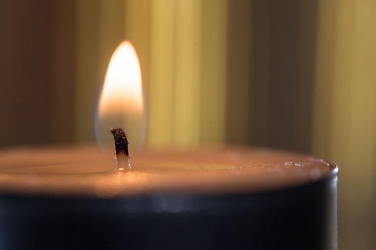 Macro shot of illuminated candle