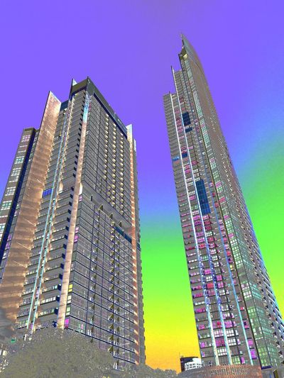 Apartment Architecture Blue Building Building Exterior Built Structure City Cityscape Development Financial District  Low Angle View Modern Nature No People Office Office Building Exterior Outdoors Purple Residential District Sky Skyscraper Tall - High Tower Travel Destinations Various Colors