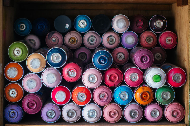 Colorful Aerosol Cans In Cabinet