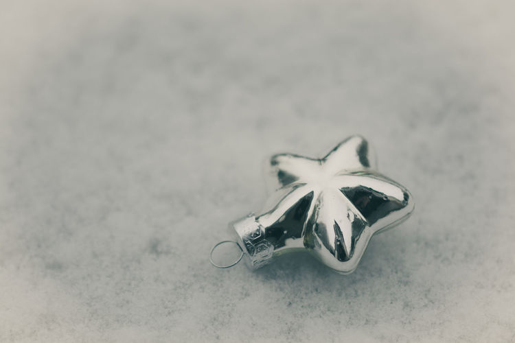 Christmas decorations in snow Christmas Platinum Shiny Winter Backround Christmas Decoration Close-up Day Free Space For Text No People Selective Focus Silver  Single Object Snow Snowflakes Star Still Life Traditional
