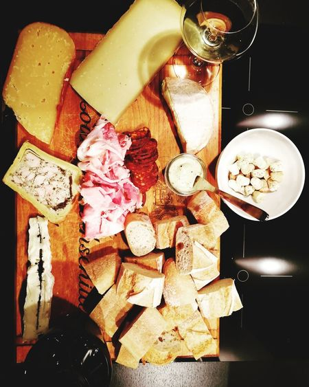 Night in with 💙 Axt Truffle Fromagerie Cheese Ham Amazing Food Wine Vins Baguette Charcuterie Table Indoors  Still Life Food And Drink No People Drink High Angle View