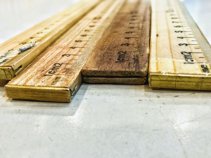 Close-Up Of Rulers On Table