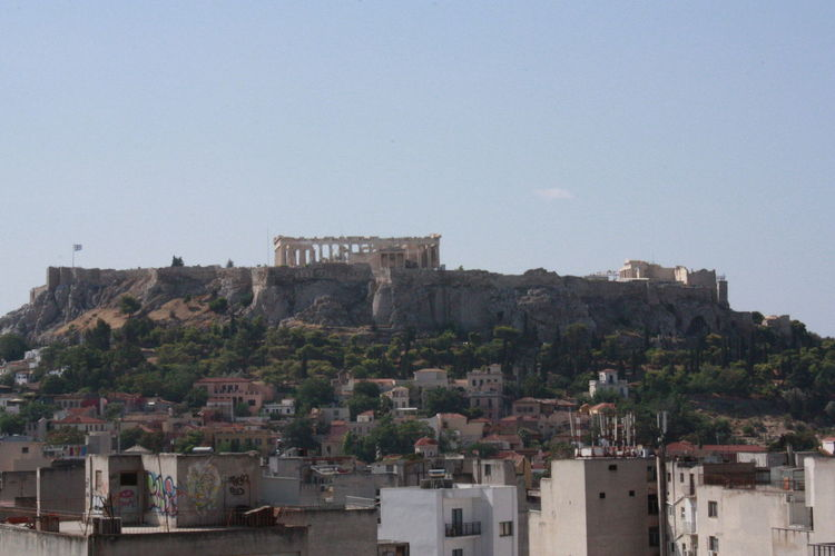 Acropolis Architecture Athens Building Exterior Built Structure City Cityscape Clear Sky Copy Space Day History No People Outdoors Residential Building Sky Tourism Travel Travel Destinations Tree