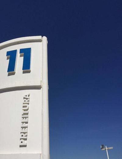 11 11 Blue Clear Sky Sky Low Angle View Built Structure Nature No People Architecture Sunlight Text Building Close-up Outdoors Western Script White Color Copy Space Building Exterior Day Communication Sunny