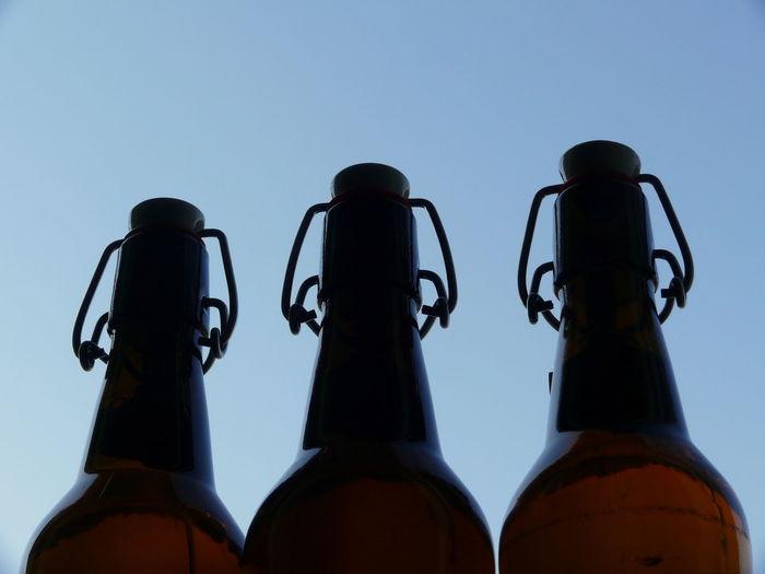 Beer Beerbottles Bottle Bottles Bügelverschluss Clear Sky Day Low Angle View No People Outdoors Pair Sky Three Wine Moments