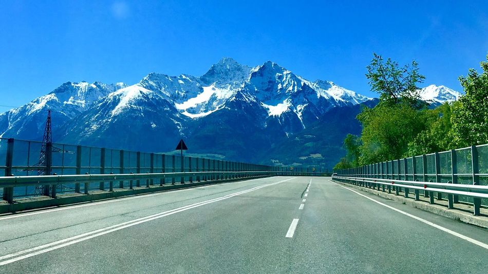 Road to Alps Mountain Road Blue Snow Nature Snowcapped Mountain Cold Temperature Scenics No People Swiss Alps Swiss Alps Switzerland Raw IPhone IPhoneography Connected By Travel Travel Destinations The Great Outdoors - 2017 EyeEm Awards Landscape Beauty In Nature Day Shades Of Winter An Eye For Travel