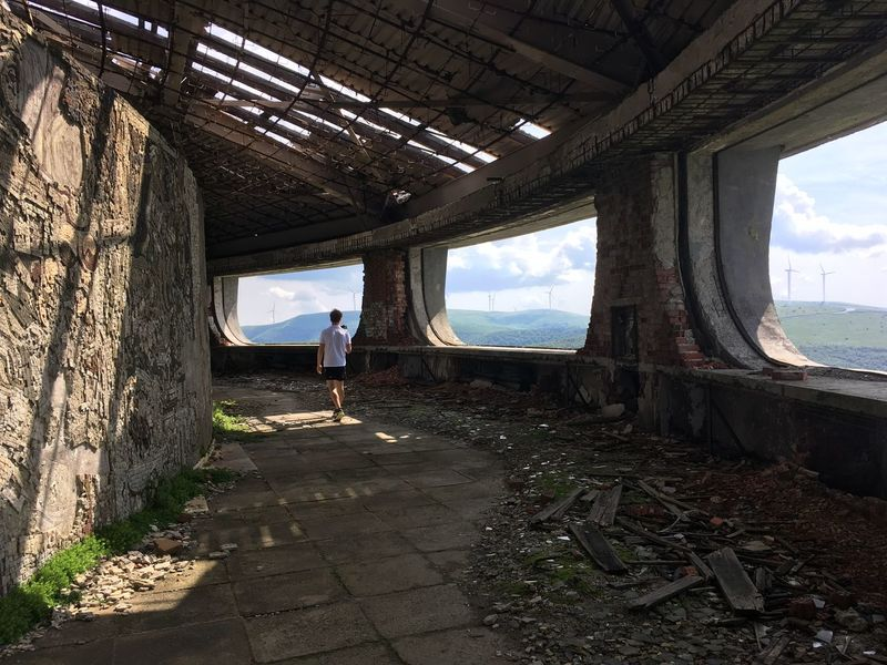 Buzludza, abandoned soviet building Abandoned Abandoned Places Architecture Buzludja Buzludzha Damaged Dangerous Day Exploration Full Length Grandiose Lifestyles Men One Person People Real People Sky Soviet Standing Sunlight Travel Destinations Traveling Traveller Ussr Wreck