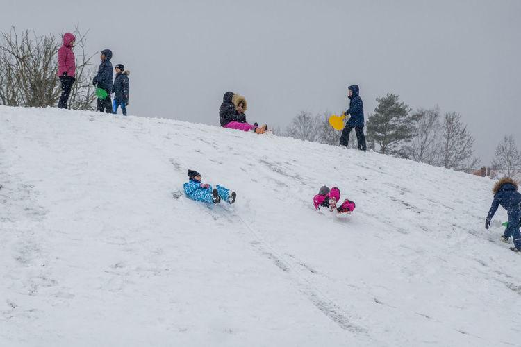 People on snowy field