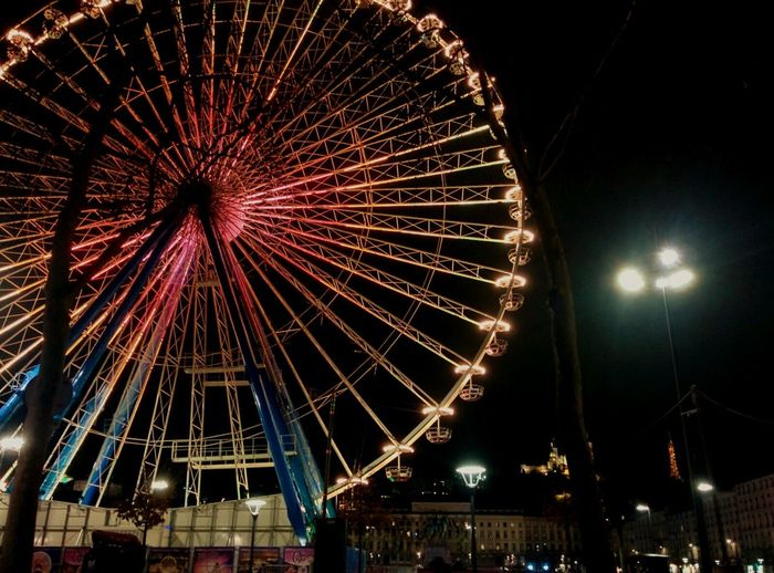 Night Illuminated Ferris Wheel Sky Celebration Outdoors City Amusement Park Ride Motion Amusement Park Exploding Firework Display Firework - Man Made Object No People Cityscape Midnight France Architecture Nature City Tranquility Town Vacations TOWNSCAPE Built Structure
