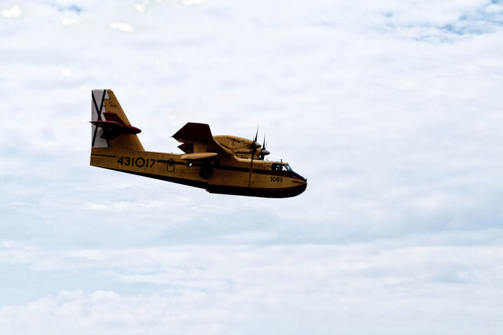 Air Force Air Vehicle Airplane Blue Canadair Cloud - Sky Day Fighter Plane Firefighter FireFighting  Flying Low Angle View Military No People Outdoors Red Sea Sky Water Yellow