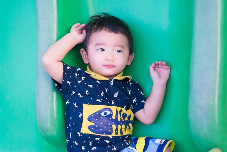 Innocent boy on slide