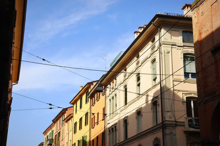 Bologna Bologna, Italy Streetphotography Street Photography City Cable Sunny Sky Architecture Building Exterior Built Structure Residential Structure Residential District Townhouse Tiled Roof  TOWNSCAPE Cityscape Old Town Row House Tiled Roof  Building Skyline