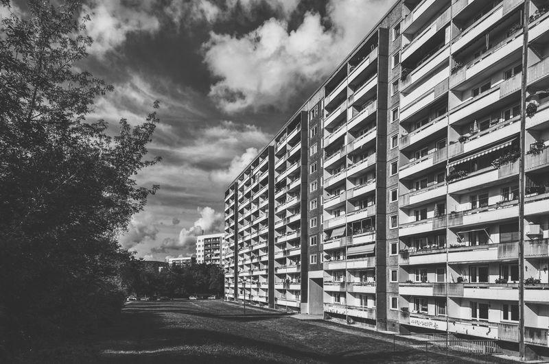 Street by buildings against sky