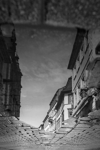 The puddle Weitwinkelige Perspektive Wideangel Tamron Nikond750 Nikon Schwarzweiß Blackandwhite Black And White Spiegelung Im Wasser Spiegelung Starbucks Heidelberg Pfütze Puddle Reflection No People City Cloud - Sky Day Outdoors House
