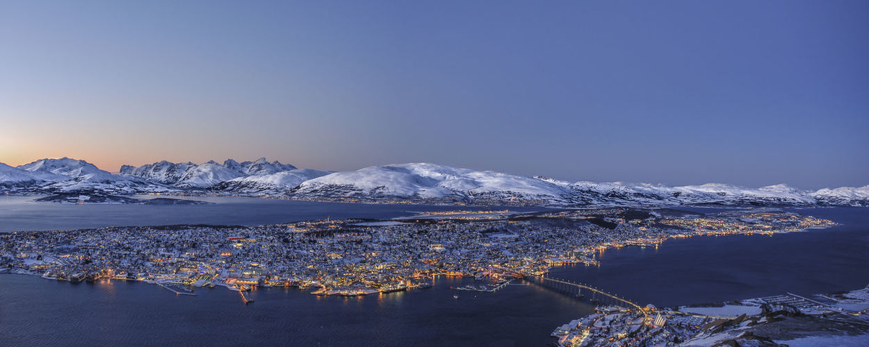 Tromsø Beauty In Nature Blue Clear Sky Cold Temperature Day Frozen Glacier Ice Lake Landscape Mountain Mountain Range Nature No People Outdoors Reflection Scenics Sky Snow Snowcapped Mountain Tranquil Scene Tranquility Travel Destinations Water Winter