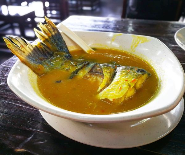 silver catfish in gravy Comfort Food Silver Catfish Gravy Cooking Bowl Traditional Food Of Malaysia Malaysia Hot Spicy And Sour Delicious Patin Masak Tempoyak Table Close-up Food And Drink Soup Prepared Food
