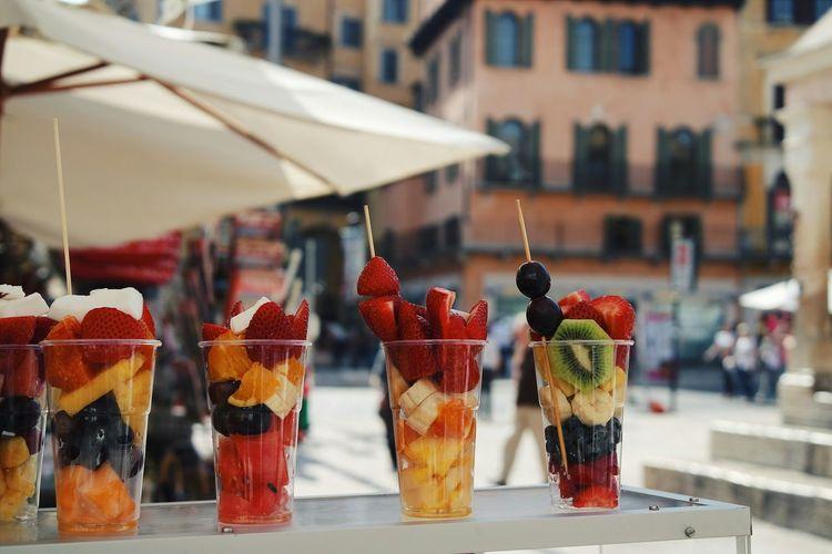 Glasses full of fruit salad on table