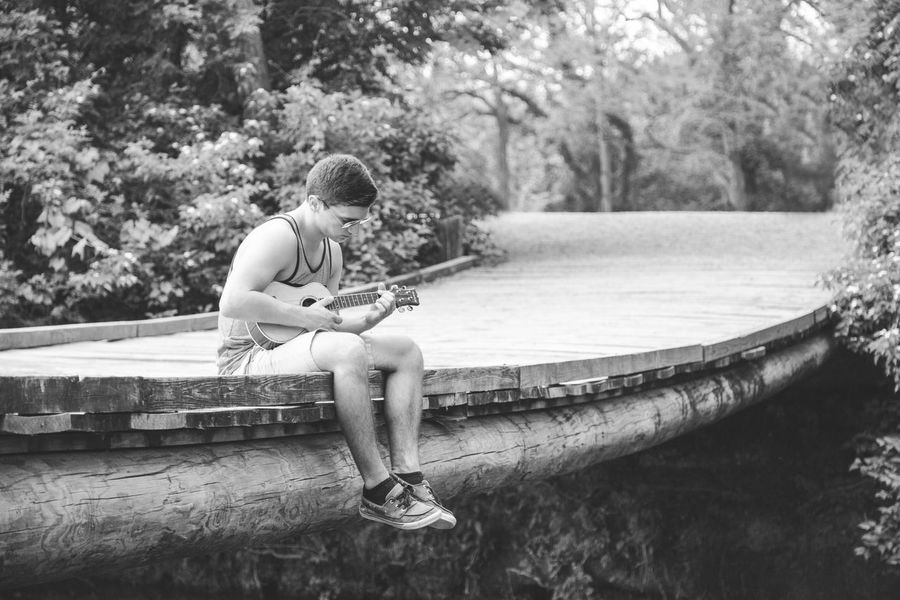 Attractive Black And Whie Bridge Day Full Body Full Length Male Man Monochrome Nature One Person Outdoors Person Playing Music Portrait Relaxed Scenics Tranquil Scene Ukelele Warm Weather Young Adult