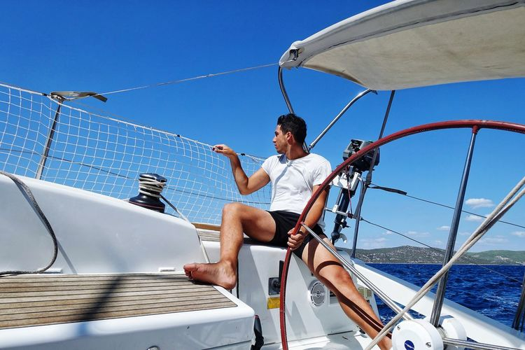 The young man & the sea Sailing Sailboat Nautical Vessell Sea Water One Man Only Vacations Summer Motion Sky One Person Adults Only Full Length Only Men Activity Travel Adult Leisure Activity Transportation Men Shirtless Sport The Week On EyeEm