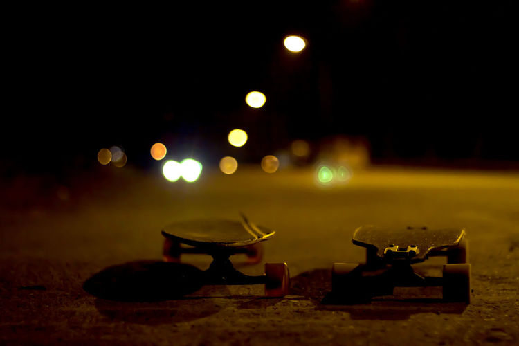 Close-Up Of Skateboards At Night