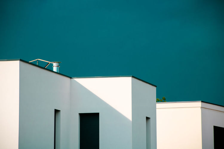 Apartment Architecture Blank Blue Building Building Exterior Built Structure Clear Sky Copy Space Day Geometric Geometric Shape High Section House Low Angle View Nature No People Outdoors Residential District Sky Sunlight Turquoise Colored Wall - Building Feature White Color Window