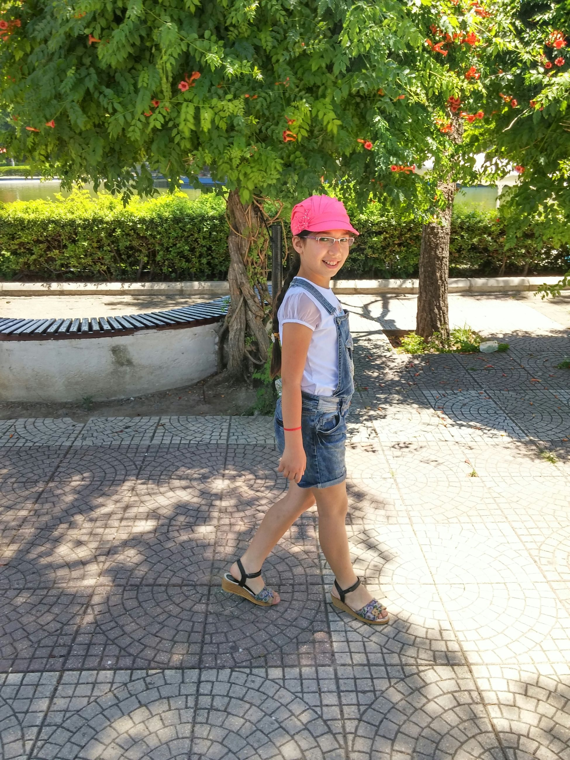 full length, childhood, lifestyles, casual clothing, leisure activity, elementary age, park - man made space, person, tree, girls, boys, sunlight, innocence, footpath, day, shadow, standing, outdoors