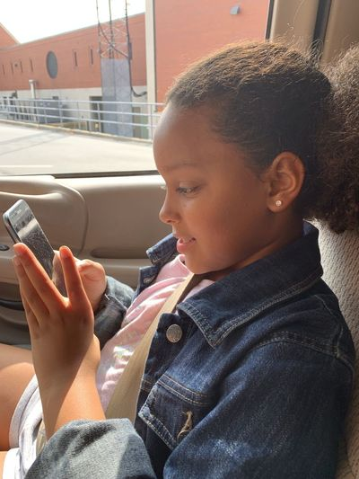 Boy looking away while using mobile phone