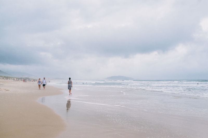 Beach Beauty In Nature Brazil Cloud Cloud - Sky Day Florianópolis Horizon Over Water Leisure Activity Lifestyles Nature Outdoors Real People Rear View Sand Scenics Sea Sky Tranquil Scene Tranquility Vacations Walking Water Wave Young Woman