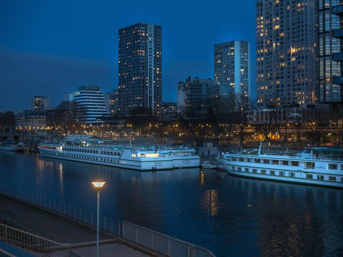 City Illuminated Architecture Building Exterior Built Structure Reflection Water Modern Sky Nautical Vessel Night Waterfront Outdoors Tranquility City I Love My City EyeEmBestPics Capture The Moment EyeEm Best Shots EyeEm Gallery The Changing City Paris, France  Cityscape Reflection