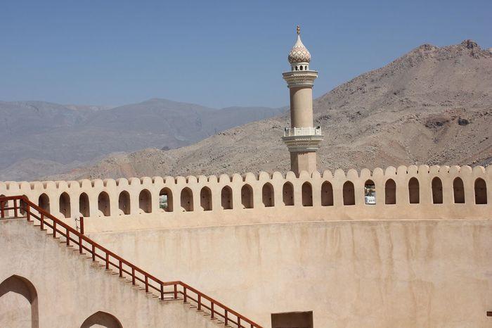Nizwa Fort Castle in Oman Arabian Architecture Castle Nizwa Fort Oman Arab Arabic Architecture Day Fortress Minaret Nizwa Oman_photo Oman_photography Sandstone
