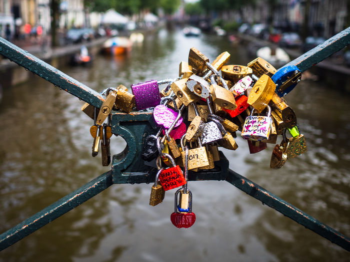 Love Locks Padlock Lock Love Lock Focus On Foreground Love River Water Safety Protection Security Positive Emotion Hanging Metal Emotion Day Bridge - Man Made Structure Bridge Hope - Concept Railing Outdoors No People Amsterdam