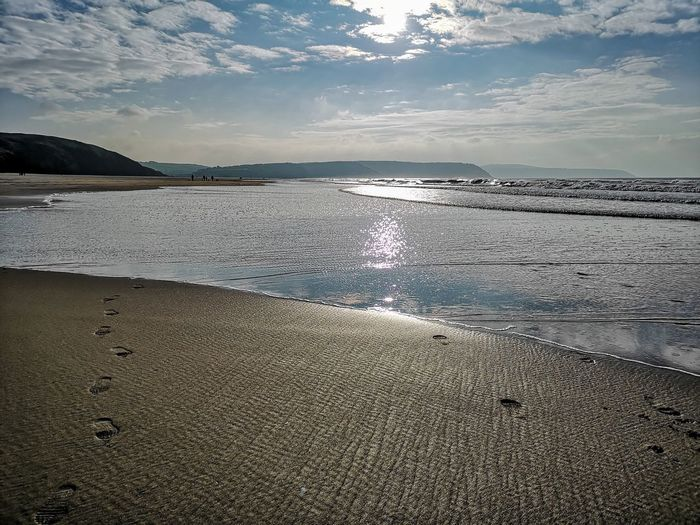 capture the beautiful moments of nature Sunrays&shimmering Water Footsteps In The Sand Autumn Exploring Eyeemphotography EyeEm Best Shots Water Low Tide Sea Wave Beach Sand Sunset Sky Horizon Over Water Seascape Calm Coastline Coast Shore Sandy Beach