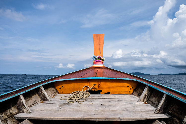 A head of long tail boat which sail on the ocean Beautiful Cloud Happiness Sunlight Travel View Boat Cloud - Sky Coast Day Horizon Over Water Island Nature Ocean Sea Seascape Sky Summer Transportation Vacation