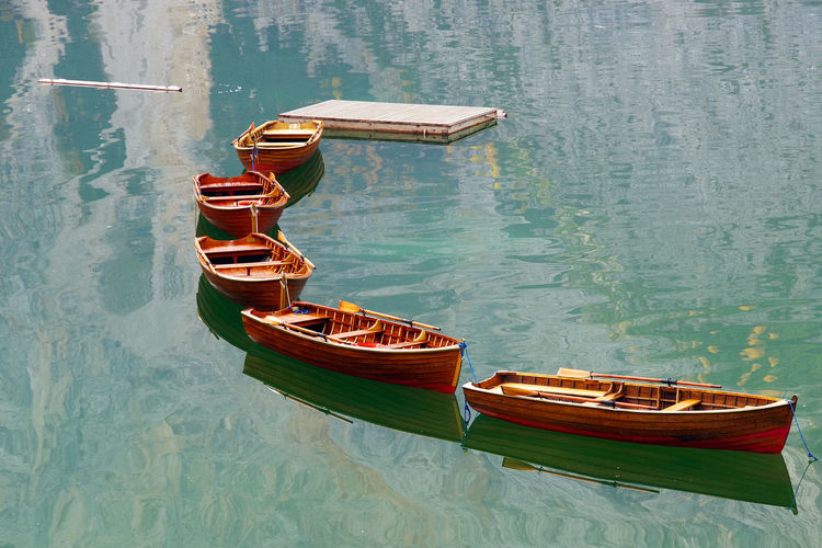 Rowboats moored in lake