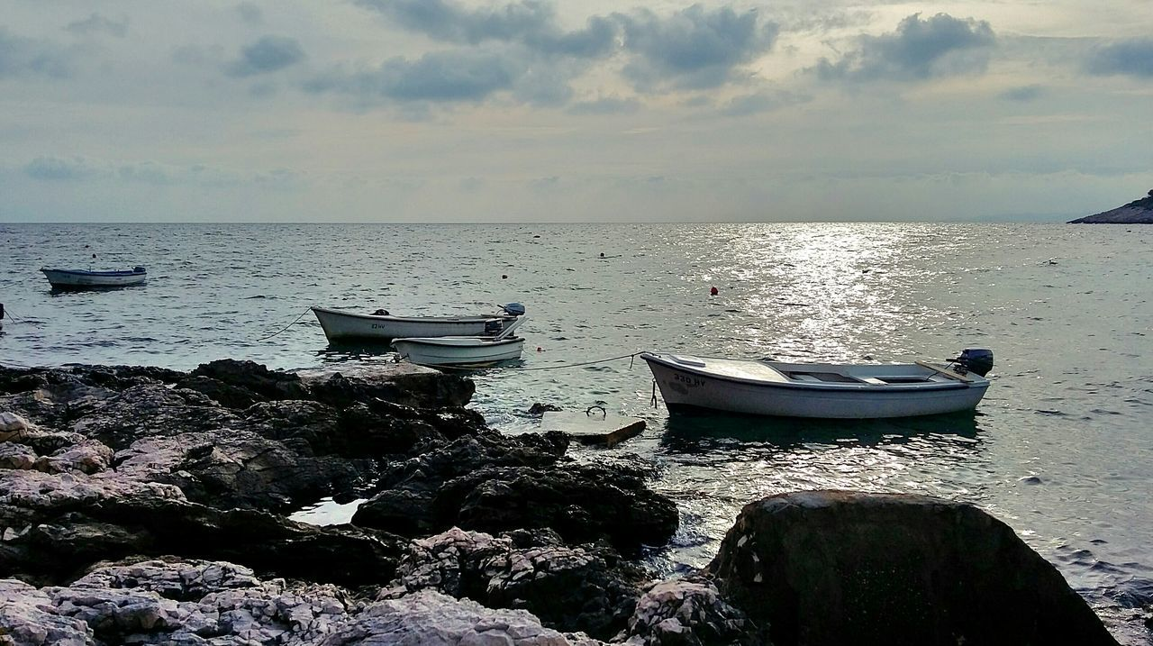 sea, water, horizon over water, beach, nature, beauty in nature, nautical vessel, scenics, sky, tranquility, tranquil scene, mode of transport, transportation, moored, rock - object, outdoors, no people, sand, cloud - sky, sunset, day