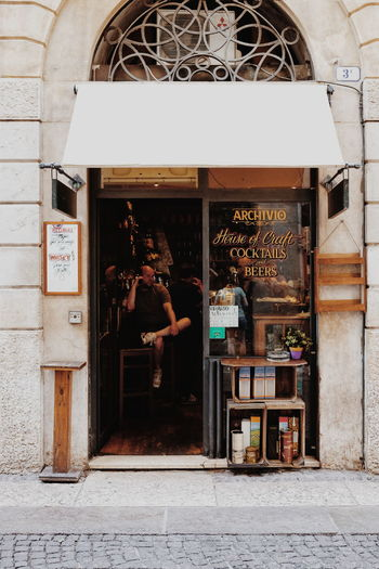 Archivio is a tiny yet adorable bar located in Verona's city centre but outside of main points of touristic interest. It offers wide selection of local wines, a few craft beers and obviously rather decent cocktails // Architecture Real People Building Exterior Outdoors Built Structure Men Day People One Person Lifestyles Bar Front Entrance FUJIFILM X-T10 XF18-55mmF2.8-4 R LM OIS F/4.0 via Fotofall