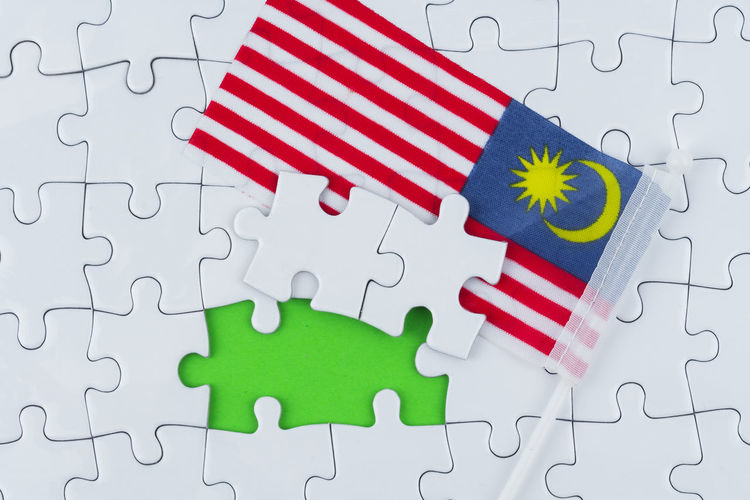 Concept puzzle and Malaysia flag with copy space for word Solution Indoors  Puzzle  Jigsaw Piece Jigsaw Puzzle Pattern Red No People Shape White Color Green Color Connection High Angle View Design Leisure Activity Table Multi Colored Studio Shot Incomplete Still Life Flag Malaysia Flag