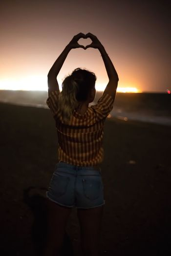 Woman's Back EyeEmNewHere City Lights Night Photography Nightphotography Heart Shape Heart With Hands Human Arm Sunset One Person Sky Real People Arms Raised Rear View Three Quarter Length Casual Clothing Hairstyle Leisure Activity Lifestyles The Creative - 2018 EyeEm Awards HUAWEI Photo Award: After Dark